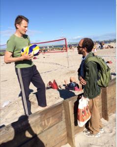Davis yuckin it up with a local volleyballer.