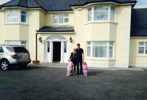 The Jones clan outside their new estate, summer 2015.